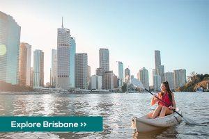 Kayaking on Brisbane river with city views